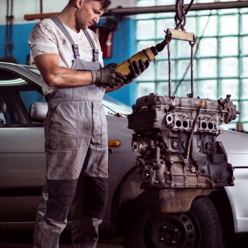 auto-mechanic-inspecting-motor-car-PDJMDP6.jpg